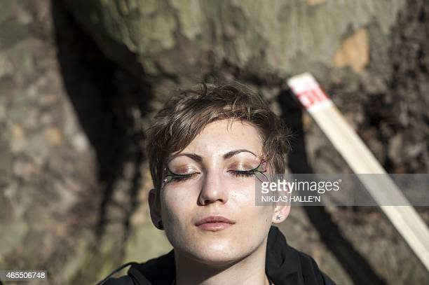 A demonstrator meditates before taking part in The People's Climate march in central London on March 7 2015 Around 5000 protesters marched on the...