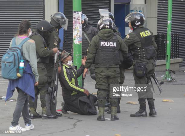 A demonstrator on his knees talks to military police officers during a protest on November 15 2019 in La Paz Bolivia Morales flew to Mexico alleging...
