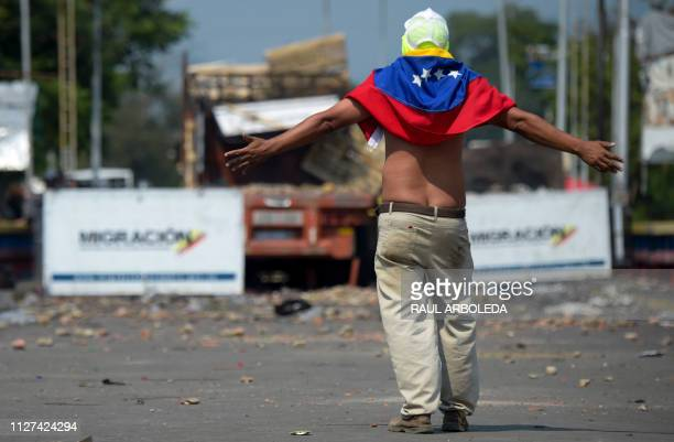 A demonstrator on the Francisco de Paula Santander International Bridge in Cucuta Colombia gestures at Venezuelan security forces blocking the bridge...