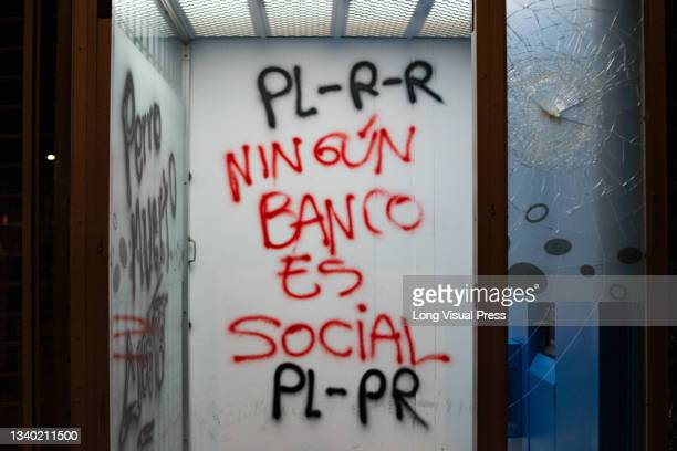 Demonstrator paints a graffiti on a bank wall that reads 'No bank is social' Villa Luz CAI police station were police officers tortured Javier...