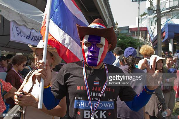 Demonstrator participating wearing a mask of the Thai flag in the anti-government campaign to 'Shutdown Bangkok'.