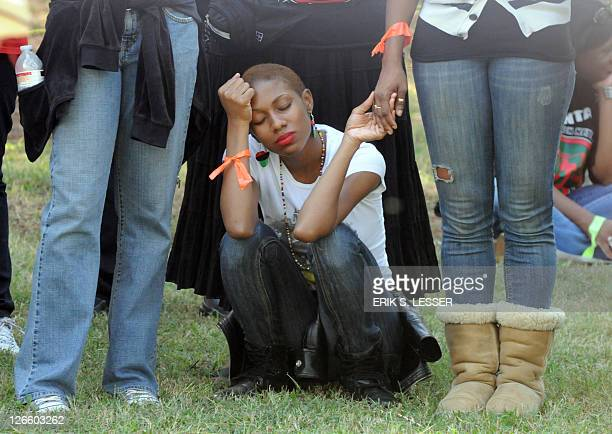 A demonstrator pauses while calling for Georgia state officials to halt the scheduled execution of convicted cop killer Troy Davis at the Georgia...