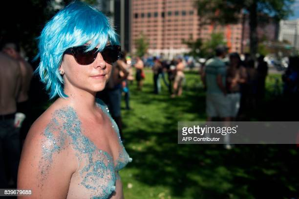 A demonstrator poses for a portrait prior to marching in the 2017 GoTopless Day Parade on August 26 2017 in Denver Colorado Founded in 2007 by the...