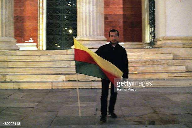 A demonstrator poses in Propylaia region in front of the University of Athens with a kurdish flag in his hands Kurds and Greek demonstrators...