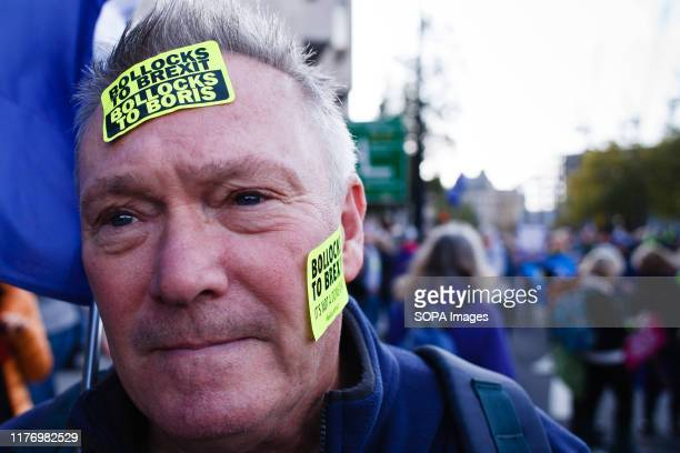 A demonstrator poses with stickers at Park Lane during the protest A mass 'Together for the Final Say' march organised by the 'People's Vote'...