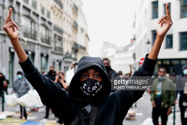 A demonstrator protest during an antiracism protest in Brussels on June 7 as part of a weekend of 'Black Lives Matter' worldwide protests against...