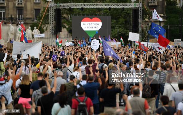 Demonstrator protest holding flags and placards in front of the Parliament building in Budapest Hungary on May 8 as members of the new Hungarian...