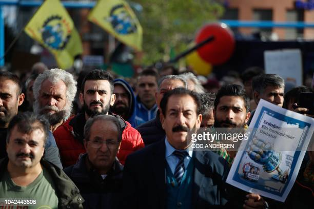 A demonstrator protesting against the policy of the Turkish President holds a poster reading Erdogan A homophobic dictator on the sidelines of a...