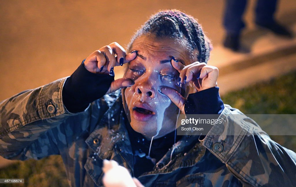 A demonstrator protesting the killings of 18-year-olds Michael Brown by a Ferguson, Missouri Police officer and Vonderrit Myers Jr. by an off duty St. Louis police officer gets help after being maced by police on October 12, 2014 in St Louis, Missouri. The St. Louis area has been struggling to heal since riots erupted in suburban Ferguson following Brown's death.
