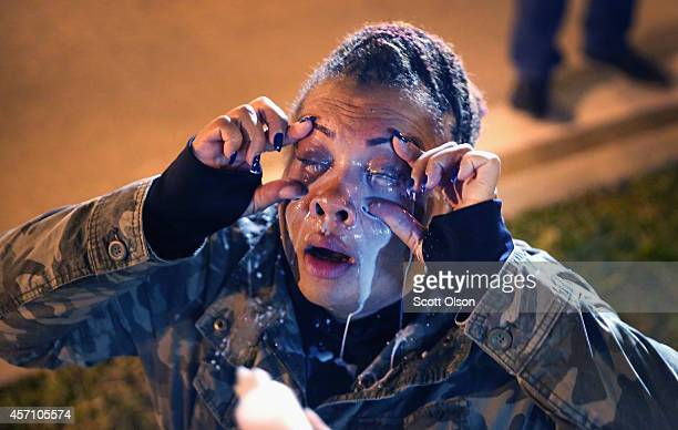 A demonstrator protesting the killings of 18yearolds Michael Brown by a Ferguson Missouri Police officer and Vonderrit Myers Jr by an off duty St...