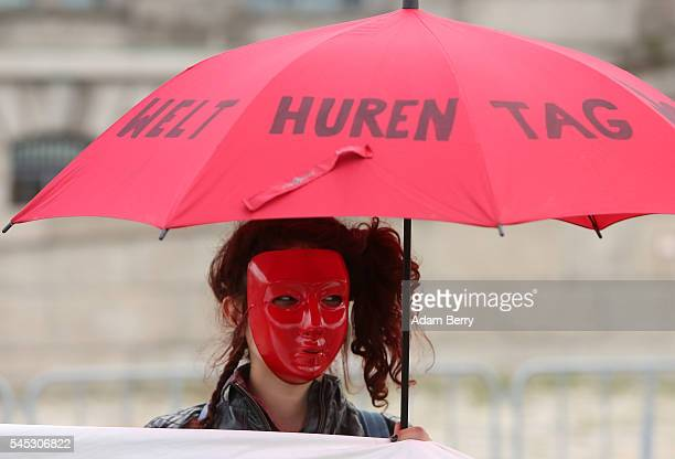 Demonstrator protests against a law requiring prostitutes to register with the government , outside of the Reichstag building, seat of the German...