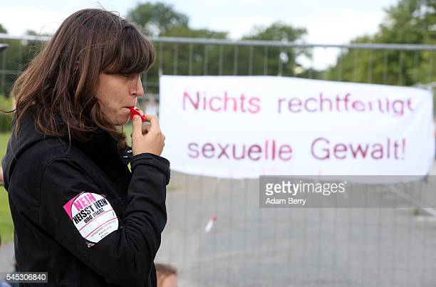 A demonstrator protests against sexual violence but also the use of laws against it that protect women but are used against refugees and other...