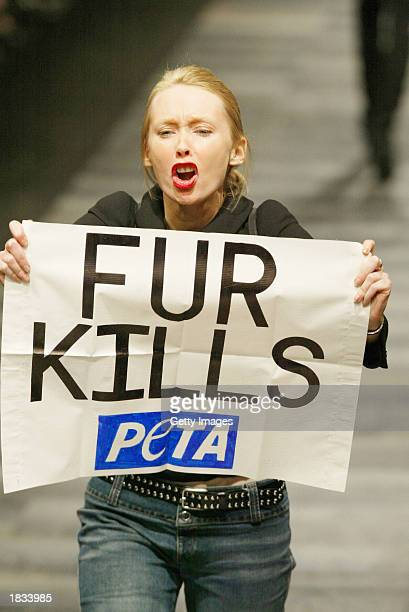 A demonstrator protests against the use of fur during the show of the Fall/Winter 2004 readytowear collection of fashion house Lagerfeld Gallery...