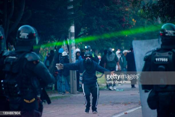 Demonstrator provokes riot police officers during anti-government that ended in clashes between protesters and Colombia's riot police amid the...