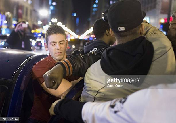 A demonstrator punches a motorist after he confronted him about blocking the intersection on December 11 2015 in Chicago Illinois A recently released...