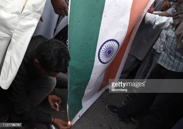A demonstrator puts a lit match to an Indian flag during an antiIndia protest in Karachi Pakistan on Wednesday Feb 27 2019 Pakistani fighter jets...