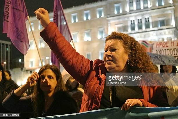 Demonstrator raises her fist in anger. Greek unions and left wing political parties organized a demonstration in Syntagma square in front of the...