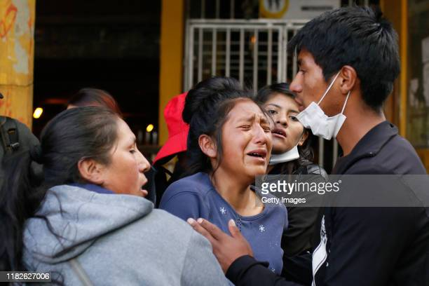 A demonstrator reacts after being shot with rubber bullets during a protest on November 15 2019 in La Paz Bolivia Morales flew to Mexico alleging a...