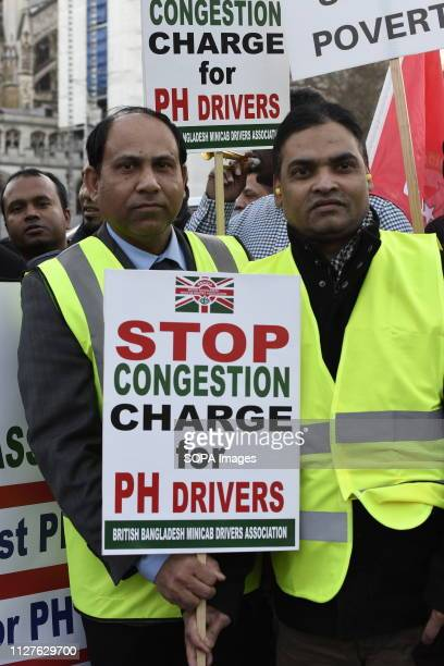 A demonstrator seen holding a placard saying Stop the congestion charge during the protest Minicab drivers blocked Parliament Square in protest over...