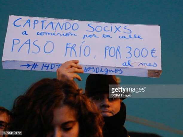 Demonstrator seen holding a sign that says Taking partners to commission on the street going cold I win 300 when the minimum wage in Spain is 7359...
