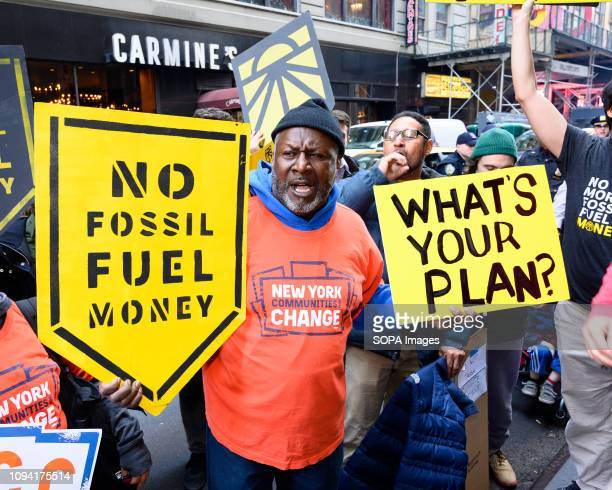 A demonstrator seen holding placards shouting slogans during the protest Multiple of groups including 350org and the Sunrise Movement sponsored a...