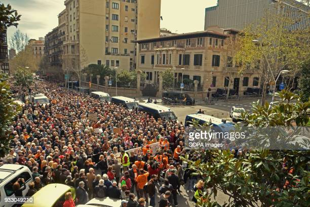 Demonstrator seen protesting at the government's headquarters in Barcelona Ten of thousands of pensioners took to the street of Barcelona during a...