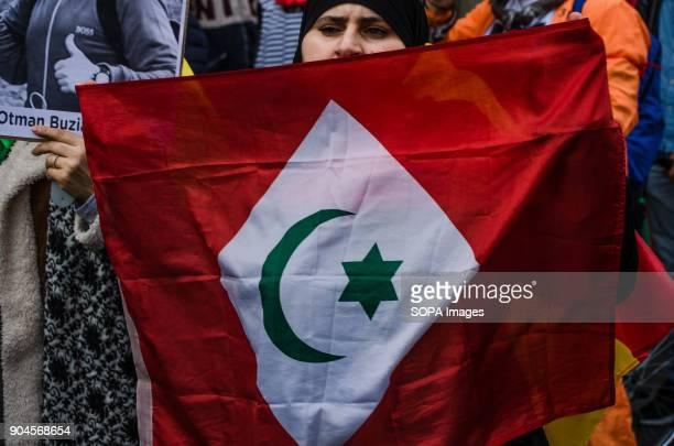 A demonstrator seen showing the flag of the Rif Third March in Barcelona by the resistance freedom and justice of the people of the Rif Striking...