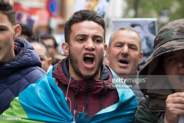 Demonstrator seen wrapped in the Amazigh flag shouting slogans during the march The riffian marched through the streets of the diaspora of Madrid to...