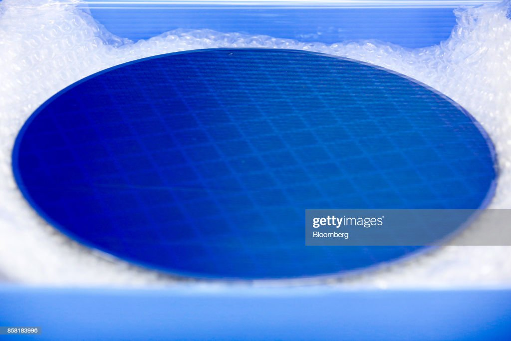A demonstrator semiconductor wafer sits in packaging in this arranged photograph at the IQE Plc headquarters in Cardiff, U.K., on Thursday, Sept. 28, 2017. IQE makes wafers that are needed for Vertical Cavity Surface Emitting Lasers (VCSELs), used for 3D sensors and widely thought to be included in the new iPhone. Photographer: Luke MacGregor/Bloomberg via Getty Images