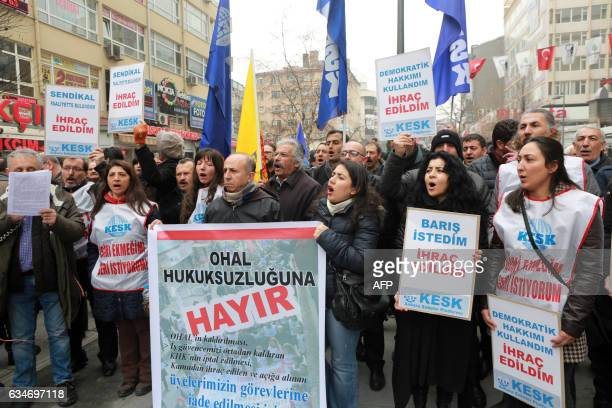 Demonstrator shout slogans and hold banners during a protest against the dismissal of academics from universities following a postcoup emergency...