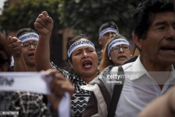 Demonstrator shout slogans during a protest against the detention of former Peruvian President Ollanta Humala and his wife Nadine Heredia outside the...