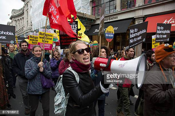 Demonstrator shouting into a megaphone at Antiracism Day demonstration led by Stand Up To Racism on 19th March 2016 in London United Kingdom Stand Up...