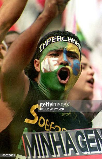 A demonstrator shouts 18 September 1992 during a protest against Brazilian President Fernando Collor de Mello in Sao Paulo Brazil Some 400000 people...