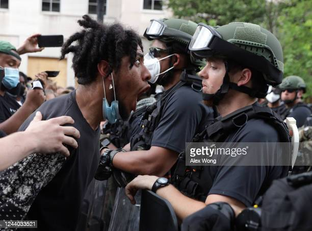 A demonstrator shouts a law enforcement officer during a peaceful protest against police brutality and the death of George Floyd on June 3 2020 in...