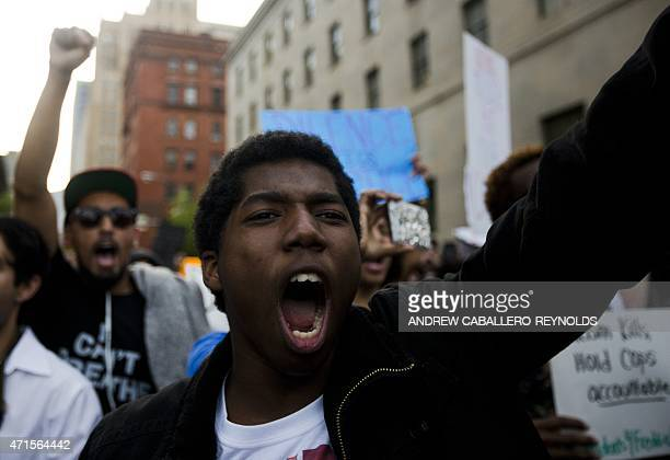A demonstrator shouts during a protest in downtown Baltimore Maryland on April 29 seeking justice for an AfricanAmerican man who died of severe...