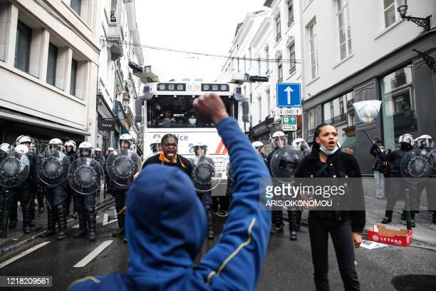 A demonstrator shouts during an antiracism protest in Brussels on June 7 as part of a weekend of 'Black Lives Matter' worldwide protests against...
