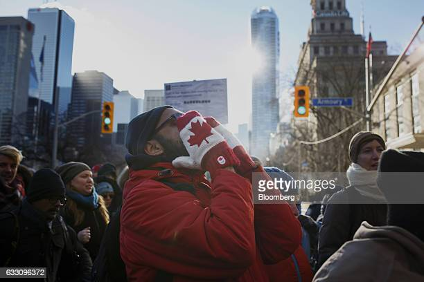 A demonstrator shouts outside of the US Consulate General during a protest in Toronto Ontario Canada on Monday Jan 30 2017 Canada's technology...