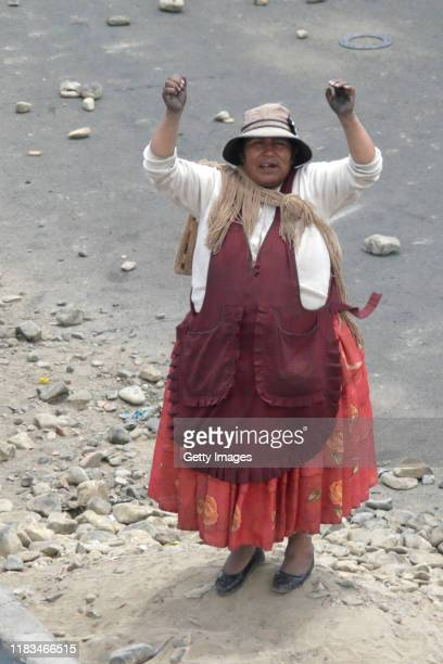 Demonstrator shouts slogans against Interim President Jeanine Añez as supporters of Evo Morales Ayma clash with police during protests on November...