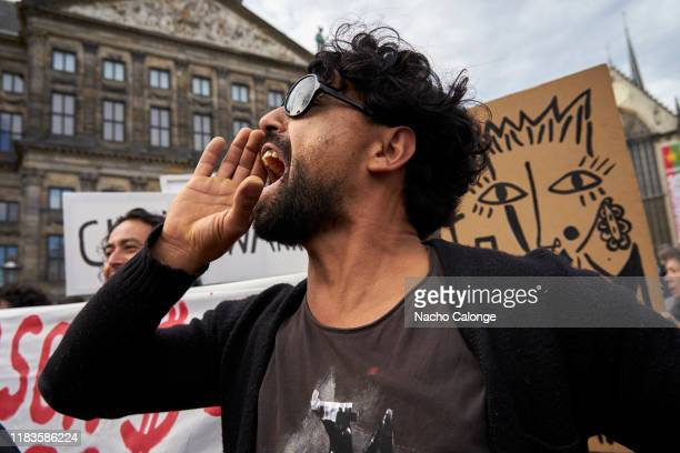 A demonstrator shouts slogans against the Chilean government during the demonstration organized today in Amsterdam in support of the Chilean...