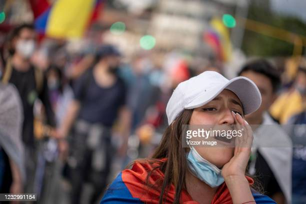 Demonstrator shouts slogans during a protest as part of a national strike on May 19, 2021 in Bogota, Colombia. Colombians continue to take the...