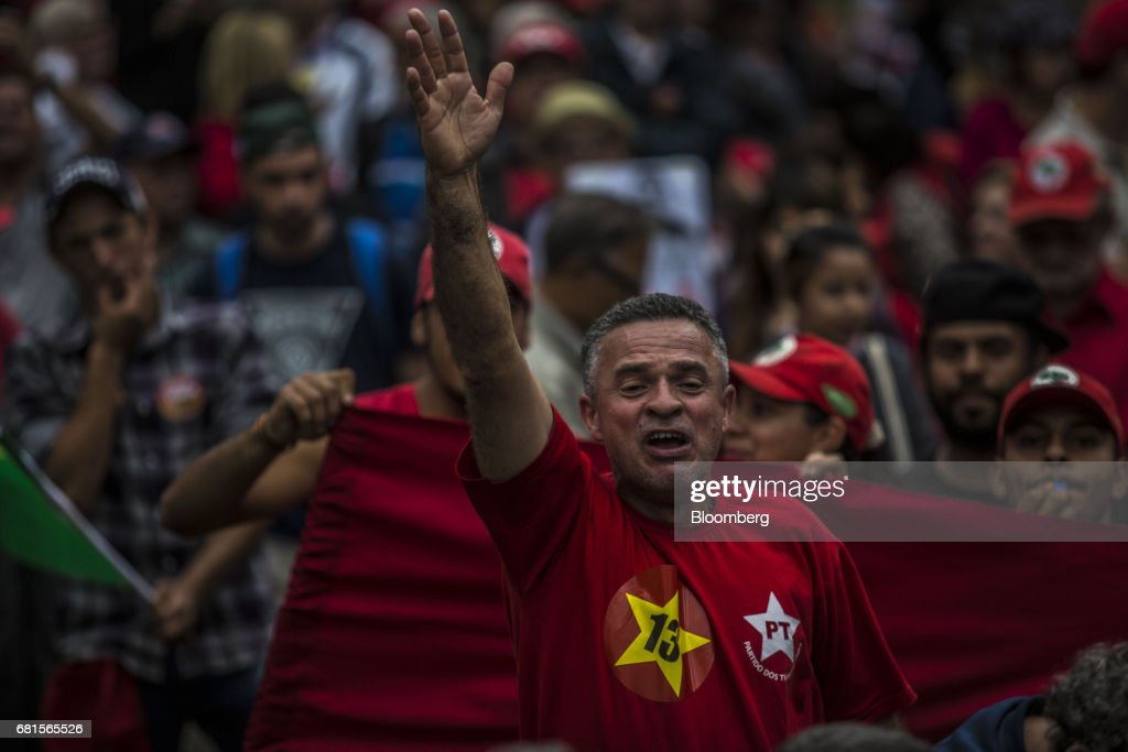 A demonstrator shouts slogans during a protest in support of Luiz Inacio Lula da Silva, former president of Brazil, on the day Lula is scheduled to testify before Sergio Moro, the lead jurist in the sprawling corruption probe known as Operation Carwash, in Curitiba, Brazil, on Wednesday, May 10, 2017. Thousands of Brazilians are descending on the southern city of Curitiba before a showdown between one of the most popular leaders in the country's history and its most famous judge at a hearing that could determine the republic's future. Photographer: Dado Galdieri/Bloomberg via Getty Images