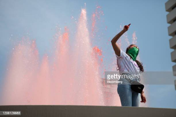 A demonstrator shouts slogans during a rally on International Women's Day in Mexico City Mexico on Friday March 8 2020 The United Nations first...