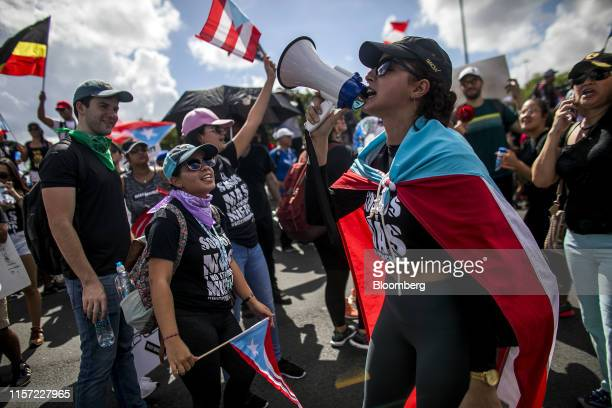 A demonstrator shouts slogans into a megaphone during a protest in San Juan Puerto Rico on Monday July 22 2019 Puerto Rico Governor Ricardo...