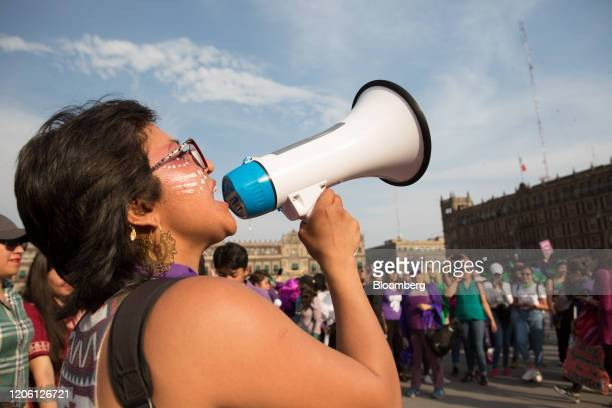 A demonstrator shouts slogans through a megaphone during a rally on International Women's Day in Mexico City Mexico on Friday March 8 2020 The United...