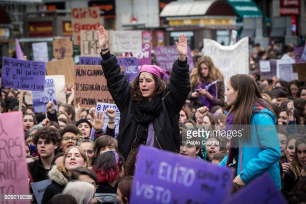 A demonstrator shouts slongans as she protests at the Puerta del Sol square during a one day strike to defend women's rights on International Women's...