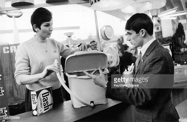 Demonstrator Showing A Consumer The Modes Of Use Of A Portable Washing Machine At The 35Th Showroom Of Home Economics At The Palais De La Defense In...