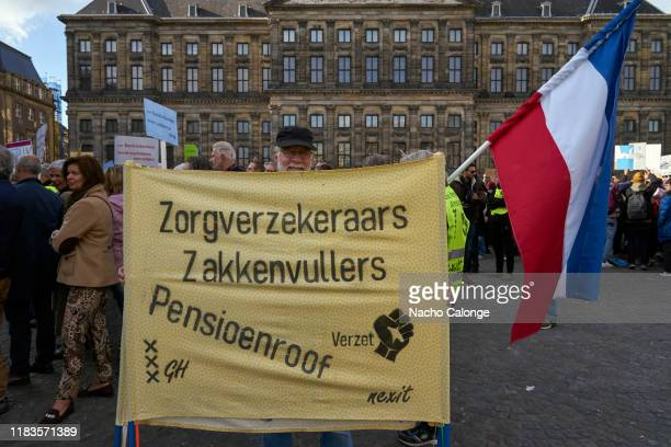 Demonstrator shows banner blaming insurance companies for stealing pension money on October 26 2019 in Amsterdam Netherlands The protesters called...