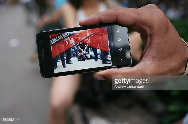 A demonstrator shows off a downloaded photograph of himself being arrested earlier in the week during the second week encampment of the 'Occupy Wall...
