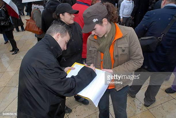 A demonstrator signs a petition as part of a protest by bar owners against French antismoking laws in Rouen northern France on Wednesday April 2 2008...