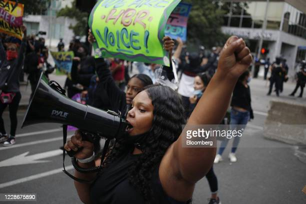 A demonstrator speaks into a bullhorn during a protest in Louisville Kentucky US on Wednesday Sept 23 2020 Kentucky won't pursue murder charges...